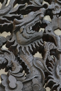 Closeup of dragon on roundel, after conservation.