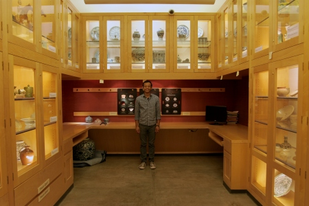Collections Management Assistant Cesar in the newly reinstalled Snukal Gallery